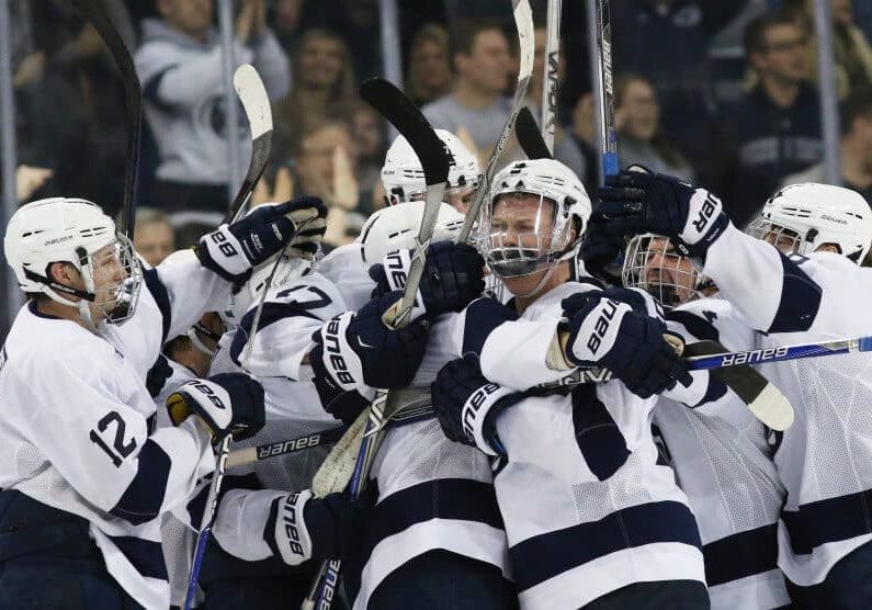 Penn State hockey players celebrating